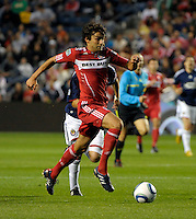 Chicago midfielder Baggio Husidic (9) dribbles toward the Chivas goal.  The Chicago Fire tied Chivas USA 1-1 at Toyota Park in Bridgeview, IL on May 1, 2010.
