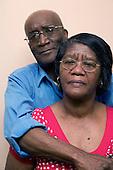 Older couple embracing.  MR