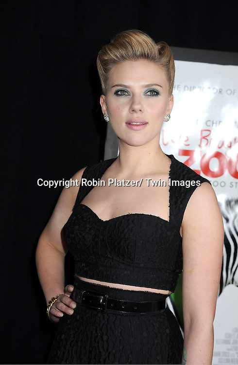 "Scarlett Johansson in Dolce and Gabbana black dress attends The New York Screening of ""We Bought A Zoo"" on December 12, 2011 at The Ziegfeld Theatre in New York City. The movie stars Matt Damon, Scarlett Johansson, Thomas Haden Church, Patrick Fugit, Colin Ford, Elle Fanning and John Michael Higgins."