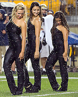 Pitt dance team members get ready to dance in the rain. The Youngstown St. Penguins defeated the Pittsburgh Panthers 31-17 on Saturday, September 1, 2012 at Heinz Field in Pittsburgh, PA.