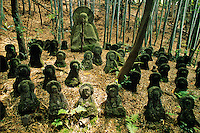Buddha statues nestle beneath a bamboo grove at the Sekihoji Temple on the southeastern edge of  Kyoto