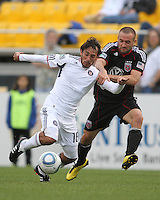 Branden Barklage#24 of D.C. United grabs Gaston Puerari#18 of the Chicago Fire during a second round match of the Carolina Challenge on March 9 2011 at Blackbaud Stadium, in Charleston, South Carolina. D.C. United won 1-0.