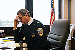 DC police commander Andy Solberg fills out paper work and reviews the weekend crime reports on Monday morning before a conference call and meeting at the command center. The meetings happen every Monday, Wednesday and Friday mornings.
