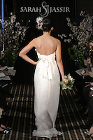 Model walks runway in a Beloved wedding dress by Sarah Jassir, for the Sarah Jassir Fall 2011 - Desire bridal collection.