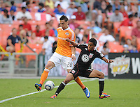 DC United midfielder Andy Najar (14) shields the ball against Houston Dynamo midfielder Geoff Cameron (20)   Houston Dynamo tied DC United 2-2, at RFK Stadium, Saturday June 25, 2011.