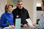 At left, Senator Lisa Murkowski (R)- Alaska speaks with elections clerk Raymond McAndews as she  files her write-in candidacy with the state division of elections Wednesday, Oct. 13, 2010 in Anchorage, Alaska.  At center is Murkowski's husband Vern.  (AP Photo / Michael Dinneen)