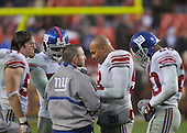 Landover, MD - November 30, 2008 -- New York Giants defensive leaders discuss strategy in the fourth quarter against the Washington Redskins at FedEx Field in Landover, Maryland on Sunday, November 30, 2008.  From left to right: linebacker Chase Blackburn (57); linebacker Danny Clark (55); defensive coordinator Steve Spagnuolo; linebacker Antonio Pierce (58); and safety Michael Johnson (20).  The Giants won the game 23 - 7..Credit: Ron Sachs / CNP.(RESTRICTION: No New York Metro or other Newspapers within a 75 mile radius of New York City)