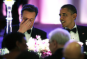 U.S. President Barack Obama (R) hosts British Prime Minister David Cameron (L) for a state dinner at the South Lawn of the White House March 14, 2012 in Washington, DC. Prime Minister Cameron was on a three-day visit in the U.S. and he had talks with President Obama earlier the day.  .Credit: Alex Wong / Pool via CNP