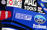 May 18, 2012; Topeka, KS, USA: Detailed view of an in memorial sticker honoring Carroll Shelby on the side of the NHRA funny car driven by Robert Hight during qualifying for the Summer Nationals at Heartland Park Topeka. Mandatory Credit: Mark J. Rebilas-