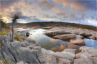 This image of Pedernales Falls State Park at sunrise (near Austin Texas) comes from a fisheye (15mm) lens and gives you nearly a 180 degree view of the Pedernales River as it winds through the park.