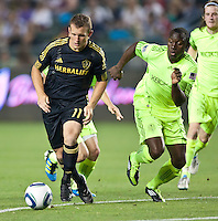CARSON, CA – July 4, 2011: LA Galaxy forward Chad Barrett (11) and Seattle Sounders defender Jhon Kennedy Hurtado (34) during the match between LA Galaxy and Seattle Sounders FC at the Home Depot Center in Carson, California. Final score LA Galaxy 0, Seattle Sounders FC 0.