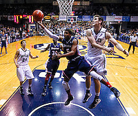 INDIANAPOLIS, IN - FEBRUARY 19: Jerry Jones #5 of the Duquesne Dukes shoots the ball as Andrew Smith #44 of the Butler Bulldogs defends at Hinkle Fieldhouse on February 19, 2013 in Indianapolis, Indiana. Butler defeated Duquesne 68-49. (Photo by Michael Hickey/Getty Images) *** Local Caption *** Jerry Jones; Andrew Smith