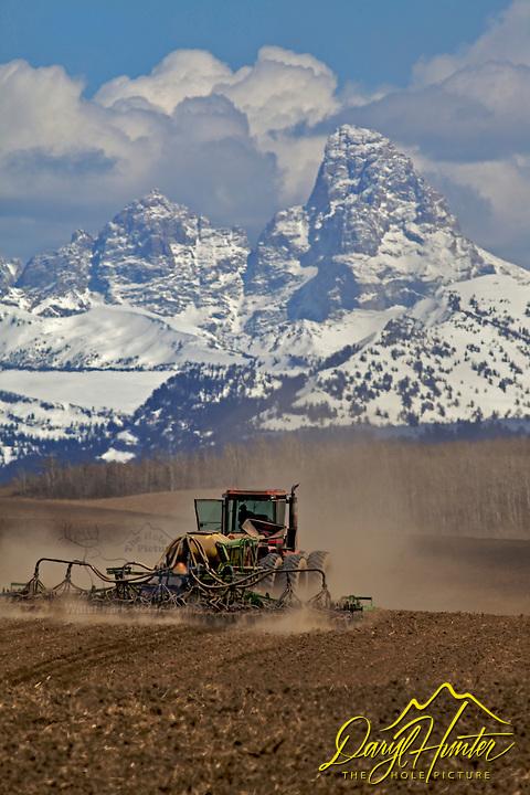 Farming in Teton Valley Idaho below the Grand Tetons.