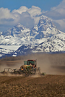 Farming in Teton Valley Idaho below the Grand Tetons.