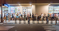 Line forms in front of a supermarket for the Upright Citizens Brigade comedy show in the Chelsea neighborhood of New York on Saturday, August 16, 2014.   (© Richard B. Levine)