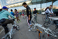"""A group of Beijingite cyclists get together for their weekly """"small tires"""" group ride near Olympic Stadium."""