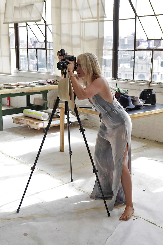 Daisy Johnson, 24, sets up for a photo with Jaime Johnson and the artist Pat Steir at her studio in Chelsea on Thursday, Sept. 8, 2011. The sisters, who are emerging photographers, are developing a photo essay about Steir...Danny Ghitis for The New York Times