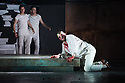 London, UK. 30.04.2014. English National Opera gives the world premiere of British composer Julian Anderson's first opera, THEBANS. Picture shows: Roland Wood (Oedipus), with Matt Casey (Eteocles) and Jonathan McGovern (Polynices) behind. Photograph © Jane Hobson.