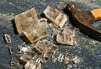 BREAKING CALCITE WITH A HAMMER<br /> (2 of 2)<br /> A Hammer Blow Shatters the Crystal<br /> The result is flat regular surfaces consisting of planes of ions.