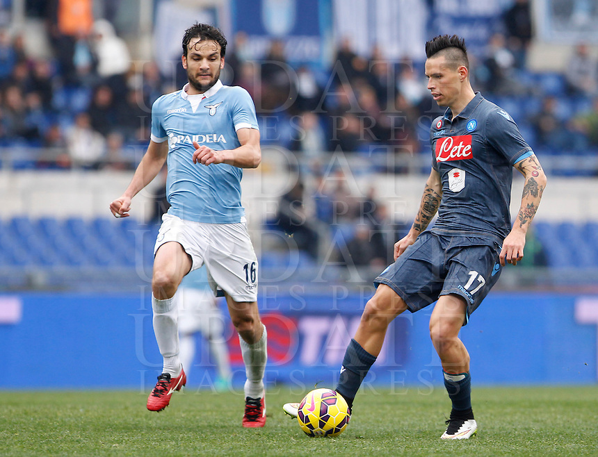 Calcio, Serie A: Lazio vs Napoli. Roma, stadio Olimpico, 18 gennaio 2015.<br /> Napoli&rsquo;s Marek Hamsik is challenged by Marco Parolo, left, during the Italian Serie A football match between Lazio and Napoli at Rome's Olympic stadium, 18 January 2015.<br /> UPDATE IMAGES PRESS/Riccardo De Luca