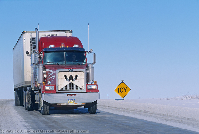Truck on the icy, winter James Dalton Highway (haul road), transporting supplies to Prudhoe bay, Arctic, Alaska.