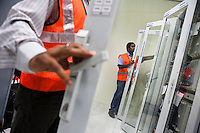Employees work on ALSTOM's STDC in the Signalling Equipment Room (SER) at the Baiyappanahalli depot and primary station in Bangalore, Karnataka, India on 10th March 2011..Photo by Suzanne Lee/Abaca Press