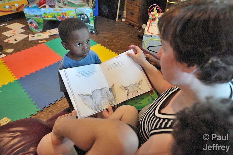 Elaine Stellini reads a book while her son Kayden, 3, observes. Stellini lives with her lesbian partner and two other boys in Vancouver, Washington. The family is active in Vancouver Heights United Methodist Church, a reconciling congregation.