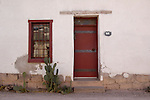 Doorway, window, and cactus in the Barrio Historico, Tucson, Arizona. The Barrio Historico was an important business area in the late 1800s, and continues to house some small businesses today.