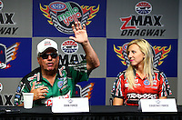 Sep 12, 2014; Concord, NC, USA; NHRA funny car driver John Force (left) and daughter Courtney Force during a press conference prior to qualifying for the Carolina Nationals at zMax Dragway. Mandatory Credit: Mark J. Rebilas-USA TODAY Sports