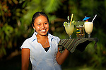 Young woman serving drinks at Chan Chich Lodge, Belize