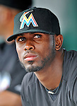 13 March 2012: Miami Marlins infielder Jose Reyes watches play from the dugout during a Spring Training game against the Atlanta Braves at Roger Dean Stadium in Jupiter, Florida. The two teams battled to a 2-2 tie playing 10 innings of Grapefruit League action. Mandatory Credit: Ed Wolfstein Photo