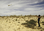 A U.S. Border Patrol agent in Del Rio, Texas, sends a search plane in the direction of suspected illegal aliens.   While the traditional mission of the United States Border Patrol has always been the detection and prevention of the illegal entry of aliens and smuggling of illegal contraband into the United States anywhere other than a designated port-of-entry, the dawn of the age of terrorism within our nation has added a new and high priority mission: to detect and prevent the entry of terrorists and their weapons into the United States. Jim Bryant Photo..&copy;2006. All Rights Reserved.
