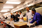 United States President Barack Obama with daughter Malia Obama, and, from left, Jeffrey Ragsdale,  Jamillah Linkins, and Marianne Ali, participate in a service project at DC Central Kitchen, on Saturday, September 10, 2011, in Washington, DC. .Credit: Leslie E. Kossoff / Pool via CNP