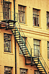 fire escape staircase on the outside of a city building