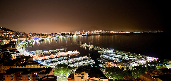 A view of the bay of Naples and the Mergellina at night.