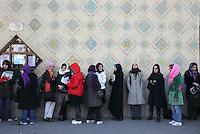 Young women waiting in a queue to buy tickets at the City theatre.
