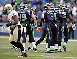Seattle Seahawks  kicker Steven Hauschka (4)  shakes hands with teammates after kicking a 49-yard field goal against the New Orleans Saints  during the 2nd round in a NFL Western Division playoff game at CenturyLink Field in Seattle, Washington on January 11, 2014.  Hauschka licked field three field goals of, 38, 49 and 26 yards as the Seahawks beat the Saints 22-15 to take home-field advantage in the NFL Championship Game. ©2014. Jim Bryant Photo. ALL RIGHTS RESERVED.