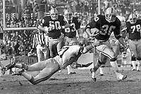 Oakland Raider Mark Van Eeghen against Seattle Seahawks #27 Autry Beaman. (1979 photo/Ron Riesterer)