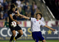 Abby Wambach (20) of the USWNT goes up for a header with Saki Kumagai (4) of Japan during the game at WakeMed Soccer Park in Cary, NC.   The USWNT defeated Japan, 2-0.