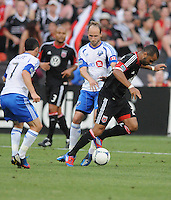 D.C. United forward Maicon Santos (29) goes against Montreal Impact midfielder Justin Mapp (21) D.C. United defeated Montreal Impact 3-0 at RFK Stadium, Saturday June 30, 2012.
