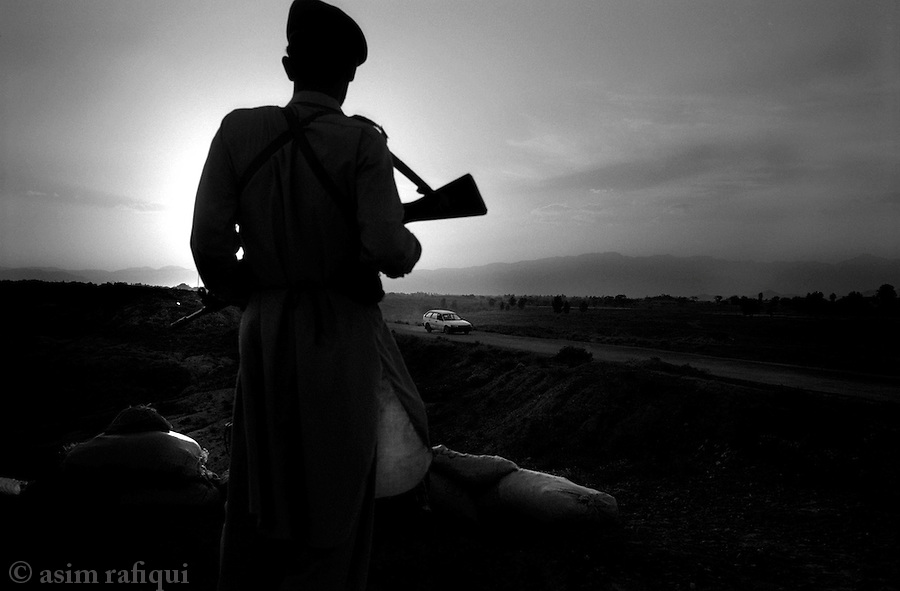 wana, waziristan, april 2004: a member of the frontier corp constabulary on evening patrol on the outskirts of wana waziristan<br />