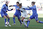 27 November 2010: Carli Lloyd (USA) (10, white) is defended by Elisabetta Tona (ITA) (5), Elisa Camporese (ITA) (10, blue), and Alessia Tuttino (ITA) (4). The United States Women's National Team defeated the Italy Women's National Team 1-0 in the second leg of their 2011 FIFA Women's World Cup Qualifier playoff at Toyota Park in Bridgeview, Illinois. The U.S. won the series 2-0 on aggregate goals to advance.