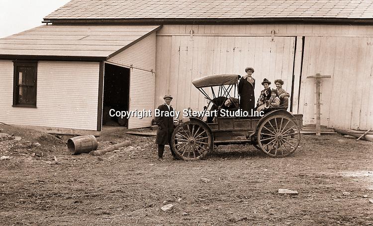 Southwestern Ohio:  Brady and Sarah Mathews Stewart and members of the Brady family posing next to the International Harvester Auto Wagon - 1916