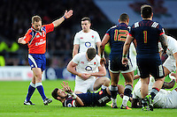Owen Farrell of England holds his wrist after suffering an injury early in the match. RBS Six Nations match between England and France on February 4, 2017 at Twickenham Stadium in London, England. Photo by: Patrick Khachfe / Onside Images