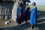 ATEKAL, TANZANIA - NOVEMBER 16: Maasai woman, stands outside their traditional house on November 16, 2009 in their village in Atekal, Tanzania. Many of their children are malnourished and they have recently been forced to eat a fruit called Atekal, from nearby trees. This fruit is only eaten during very hard times. The village has lost about 300 cattle in recent months. This area has been severely affected by drought the last two years and as many as 3-4000 cattle has died in recent months. The Maasai tribe populates the area and many of them has given up on farming and traveled to cities such as Arusha to look for work. Indigenous peoples globally, such as the Maasai in Tanzania and Kenya, are disproportionately affected by the impacts of climate change due to fragile and harsh ecosystems. (Photo by Per-Anders Pettersson)....