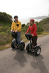 Couple on Segways, each on a Segway, on Angel Island State Park in San Francisco Bay, California, CA. Model released..Photo camari229-70429..Photo copyright Lee Foster, www.fostertravel.com, 510-549-2202, lee@fostertravel.com.