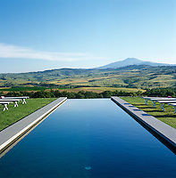 The infinity pool has the beautiful rolling Tuscan countryside as its backdrop