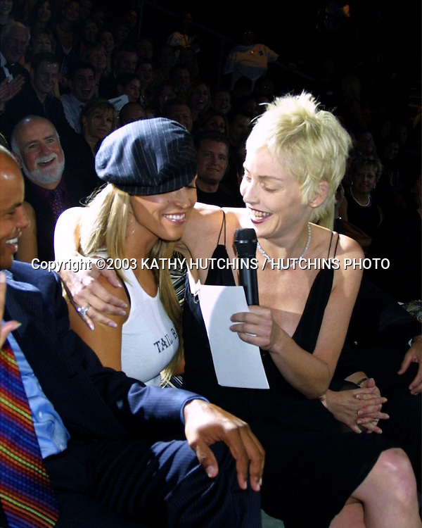 ©2003 KATHY HUTCHINS / HUTCHINS PHOTO.MACY'S PASSPORT GALA EVENING.BARKER HANGER.SANTA MONICA, CA.OCTOBER 2, 2003..JILLIAN BARBERIE.SHARON STONE..SHARON IS TRYING TO GET THEM TO BID UP ON A AUCTION SHE IS CONDUCTING TO RAISE MONEY FOR THE AIDS RELATED CHARITIES BENEFITED