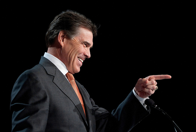 UNITED STATES – OCTOBER 7: Presidential candidate and current Texas Gov. Rick Perry speaks to reporters in the hallway after delivering a speech at the Family Research Council's Values Voter Summit in Washington on Friday, Oct. 7, 2011. (Photo By Bill Clark/CQ Roll Call)