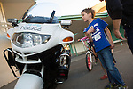 A boy checks out a Los Altos Police Department motor bike during National Night Out at Montclaire Elementary School August 8.